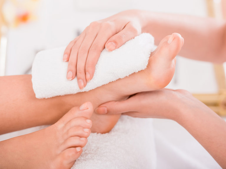 Close-up of relaxation pedicure process in spa salon.